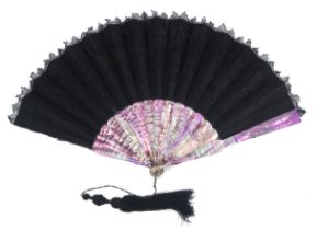 A c 1870's black lace fan mounted on Mother of Pearl dyed a vibrant purple, the floral lace leaf wit