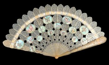 A fine circa 1820's pale horn brisé fan, carved and pierced, the twenty inner sticks and two guards