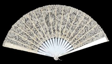 A large Mixed Brussels lace fan, the monture of white mother of pearl, c 1890's, with shaped head, t