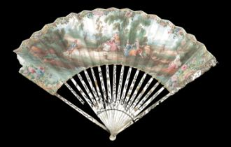 A slender 18th century fan with Mother of Pearl monture, the guards extensively carved and pierced w