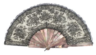 A third quarter 19th century black Chantilly lace fan, the lace with a backing of cream silk, the mo