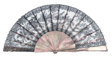A third quarter 19th century black Chantilly lace fan, the leaf of floral design, mounted on dusky T