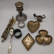 A collection of silver items to include a Reed & Barton candlestick, diamond heart and clubs dishes,