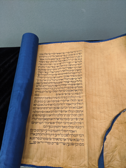 A Sephardi Megillah scroll with a blue backing