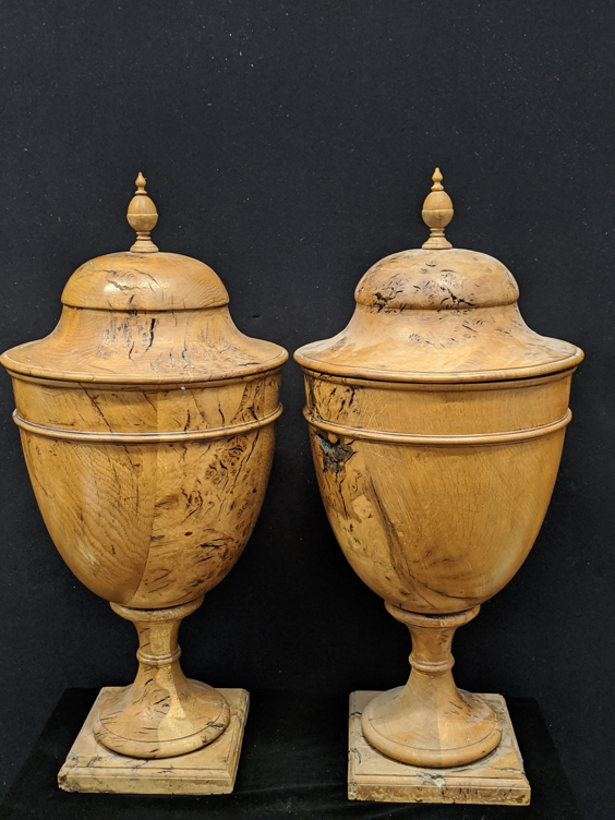 A pair of Regency olive wood urns, acorn finials, interior liners, H.61cm