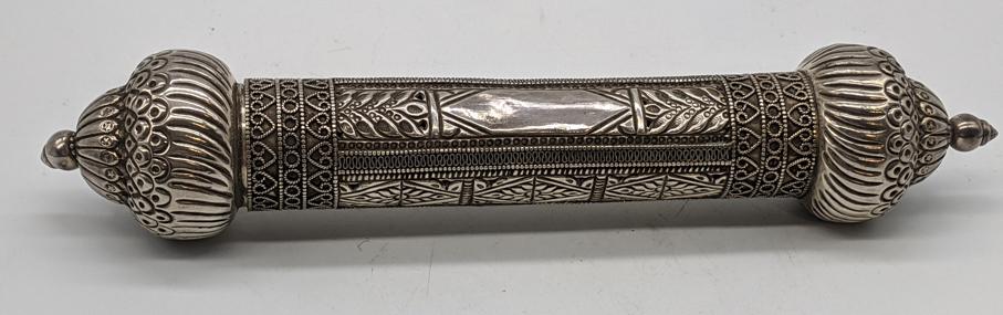 An Omani silver scroll case, vacant cartouche, 156g, L.28cm