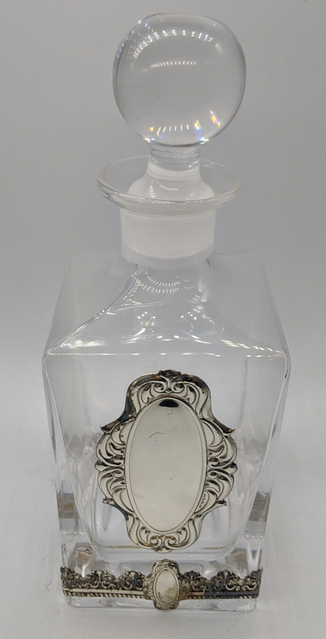 An Israeli glass decanter with silver banding and a vacant silver cartouche, H.26cm