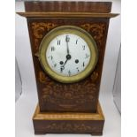 A 19th century French marquetry inlaid mantle clock with an eight-day movement, H.35.5cm