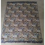 An embroidered tapestry textile rug, 70cm x 40cm