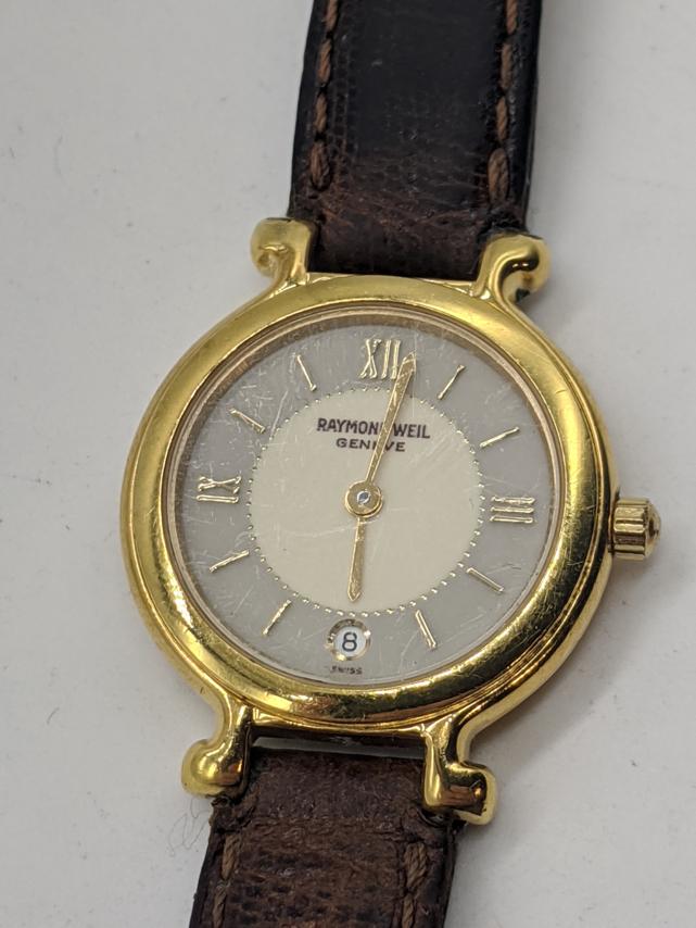 A Raymond Weil 18ct gold plated ladies wristwatch, quartz motion, brown leather strap, D.2.5cm