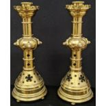 A pair of Gothic Revival brass candlesticks, mounted with stones, circa late 19th century, H.61cm