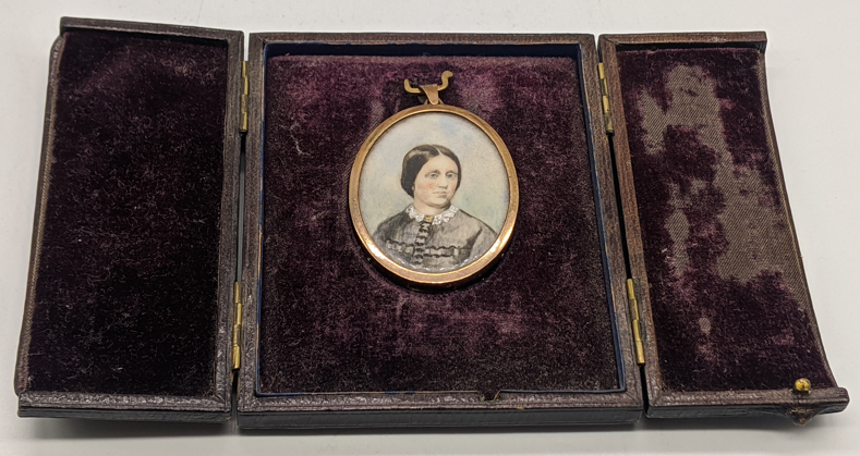 A Victorian miniature portrait of a lady, yellow metal mount, H.5cm