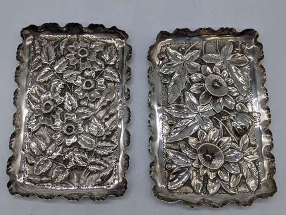 A pair of Victorian silver dishes, floral embossed designs, hallmarked Birmingham, 74g, L.10.5cm