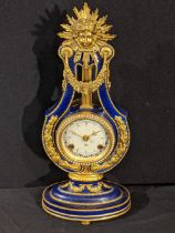 A Franklin Mint model of a Louis XVI style Marie Antionette clock, V&A issue, with key