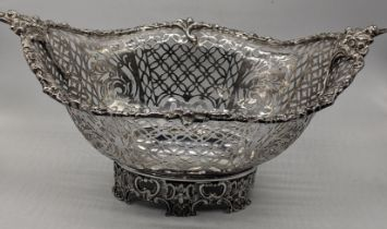 A large early 20th century century silver basket, pierced fretwork, hallmarked Birmingham, 1926,