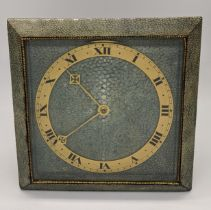 A Deco shagreen mantel clock, brass chapter ring, Roman numerals, with key, H.25cm W.25cm