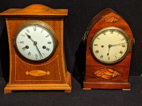 In the manner of Charles Voysey, an Arts and Crafts oak inlaid mantel clock, domed top, 8 days