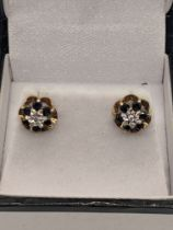 A pair of 9ct gold earrings, central diamonds, 1.6g, D 0.8mm