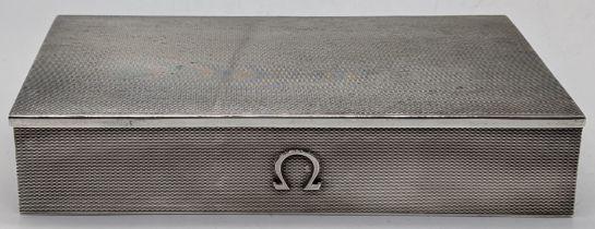 An Omega silver watch box, engine turned finish, hallmarked Birmingham, 1957, maker Atkins Bros