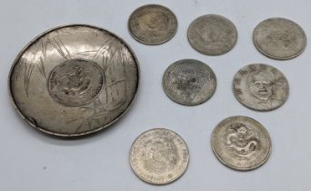 A Chinese silver coin dish together with 7 Chinese coins