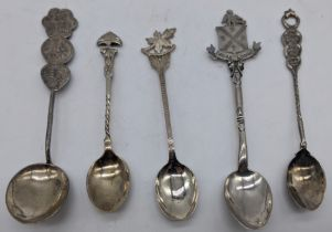 A small collection of silver teaspoons (five pieces), including one with Chinese characters, another