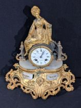 A Womelsdorf Clermont mantel clock, onyx base with applied gilt mounts, figural surmount, 8 day