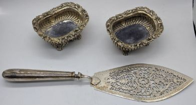 A pair of George IV sugar sifters, hallmarked London, 1822, maker George Burrows, L.10.5cm, 260g,