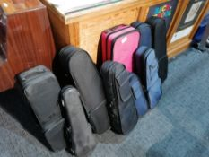 9: Various Empty Used Violin Cases