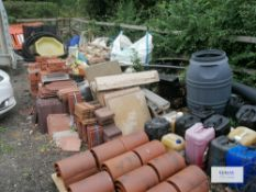 Contents of outside storage area including scafold pipes , tiles , plastic bariers , water butt as