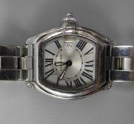 Cartier, RoadsterEdelstahl und Saphirglas. Weißes Ziffernblatt mit römischen Ziffern