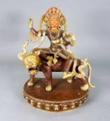 Buddhistische GottheitBronze, teils farbig gefasst, mit Emaillearbeiten versehen. Gott