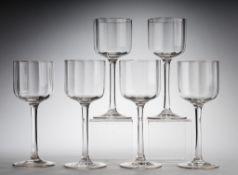 Sechs Jugendstil-WeingläserFarbloses Glas. Optisch gerippt formgeblasen. Kuppa u. Scheibenfu