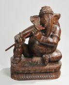 Skulptur des GaneshaHartholz, geschnitzt. Auf Lotossockel Darstellung des sitzenden Ganesha,