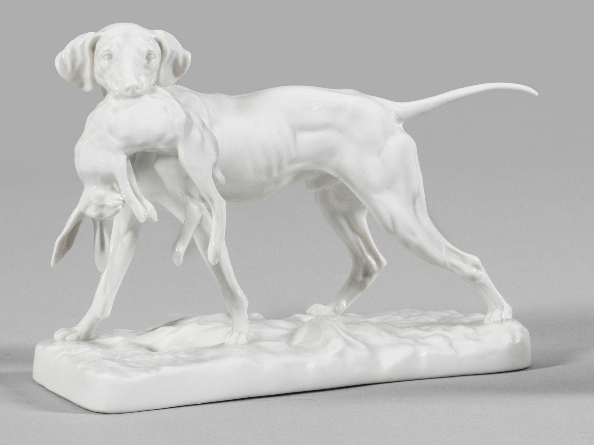 Jagdhund mit erlegtem Hasen