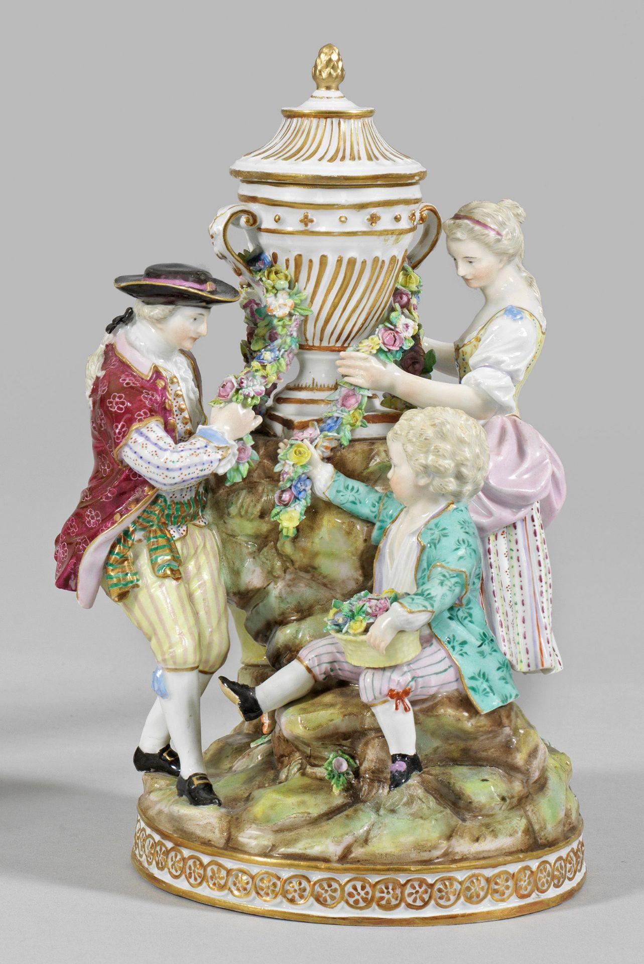 Gärtnergruppe mit Vase