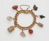 Gliederarmband mit antiken Anhängern