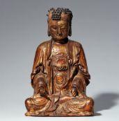 Figur eines Buddha. Holz mit vergoldeter Lackfassung. Yüan-Zeit oder später