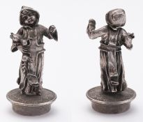 Silver bottle stopper, cast and carving, subject of a young monk picking grenades