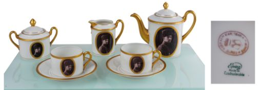 A Bohemian porcelain coffee service for two, with the portrait of Prince Şehzade Ömer Faruk