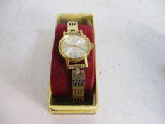 Ladies vintage Bulova wrist watch Excalibur international bracelet.