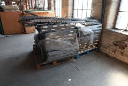 Pallet of stores shelving uprights and shelves
