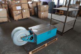 Semi automatic low table strapper