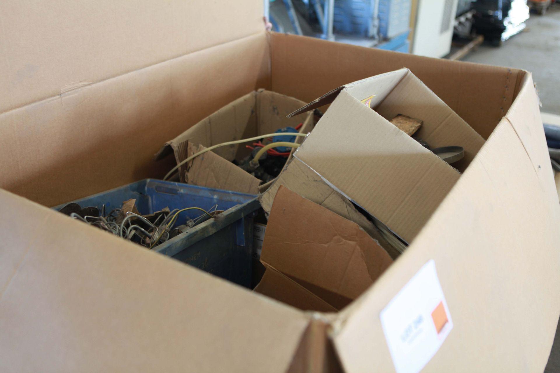 Large cardboard carton of machine spares