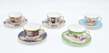 Royal Worcester Miniature Cups and Saucers: Blue Panelled Floral, Wheatsheaf, Marchiones of Huntley,