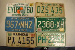 6 vintage American vehicle number plates