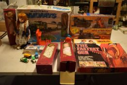 A mixed collection of items to include childrens toys, dolls, modern Corgi cars etc (lots of wear)