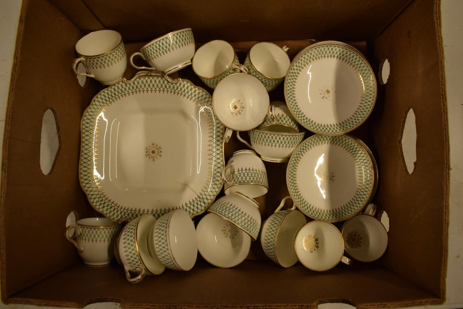 A 19th century unmarked English part tea set with green and gold decoration (mostly a/f) No postage