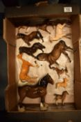 A collection of Beswick to include: horses, dogs, deer etc (all a/f)