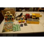 A mixed collection of vintage toys to include dumper trucks, Codeg Melody Bells etc Condition is