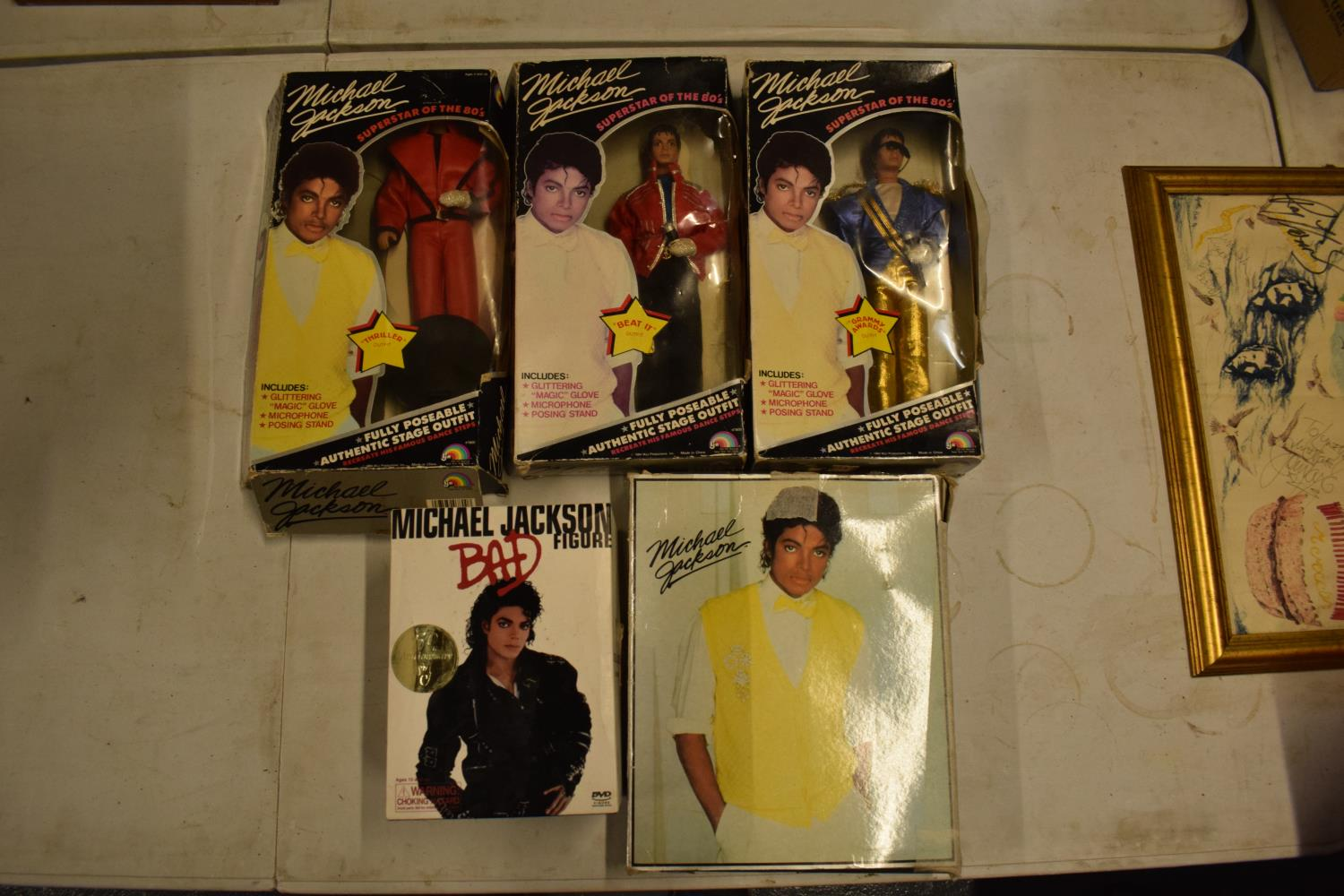 A collection Michael Jackson figures and toys to include 'BAD' figure, electronic microphone and